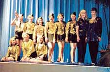 Terrific Troupe of Top Tappers Hit Town